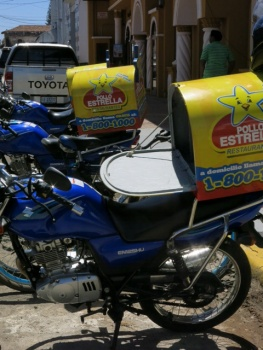 Chicken delivery bikes in Leon