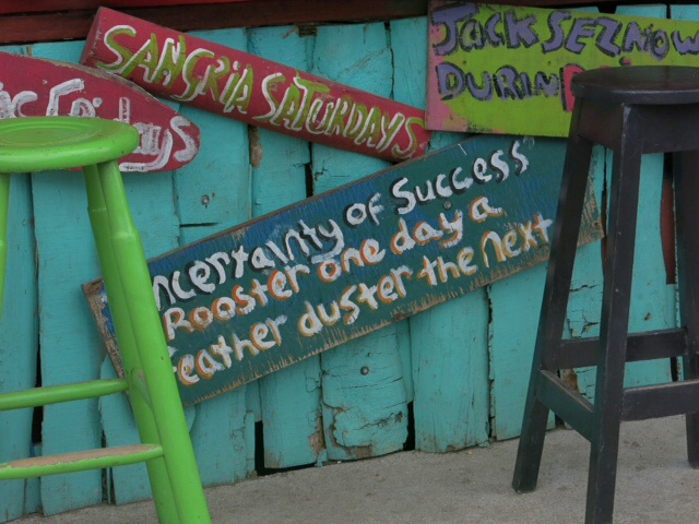 Sign on pub wall in Puerto Viejo