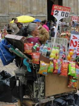 Lady selling junk food from a shopping trolley