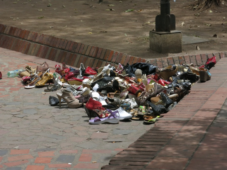 A random pile of shoes in the street!