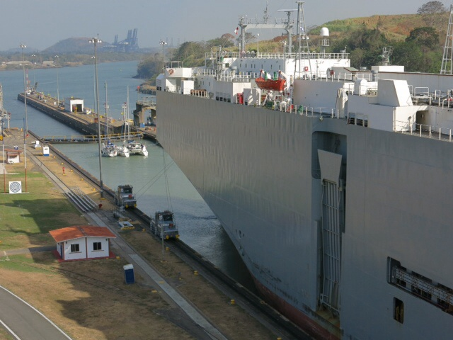 Car carrier and yachts in the last stage of the locks