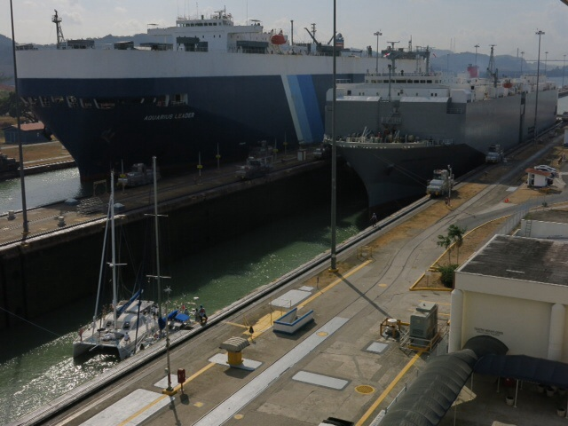Two car carriers and two yachts in the lock