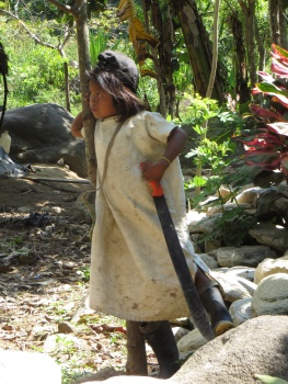 Kogui boy with a very large machete!
