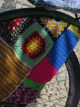 Bicycles have interesting knitted and crochet adornments!