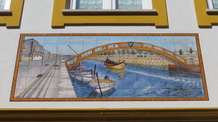 Tile mural of the bridge over the canal