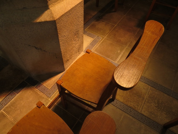 Light shining on the chairs in the church