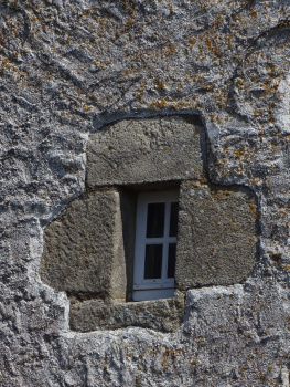 Very small window typical of the region