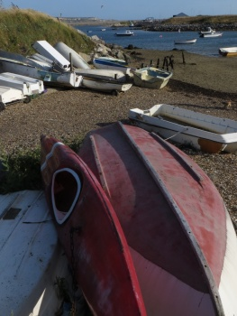 Upturned boats next to the harbour