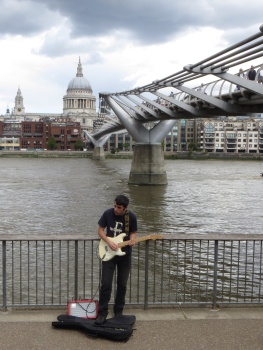 Busker on the South Bank next to the Millennium Bridge