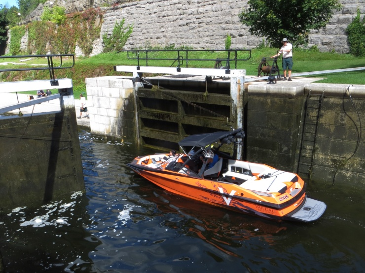 Small boat going through one of the many locks