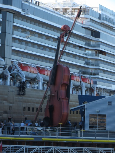 Huge double bass next to the cruise ship