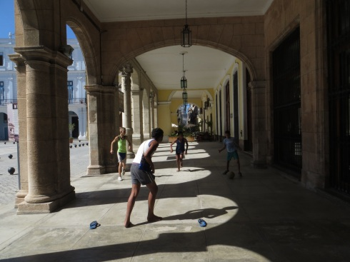 Playing football under the verandah in Plaza Viejo