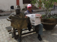 Martha Jimenez statue based on the man reading the newspaper