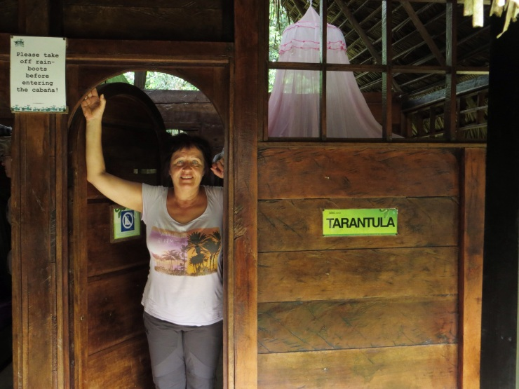Terese at the door of our cabin (no glass in the windows and, yes, it was called Tarantula!)