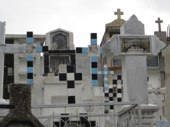 A number of the tombs had coloured tiled crosses
