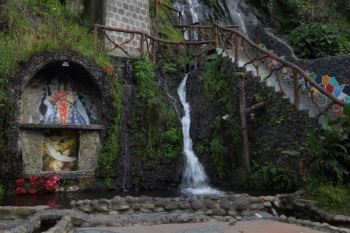 Waterfall in Banos with the inevitable shrine