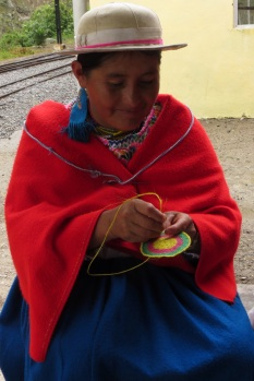 One of the dancing ladies sewing between dances