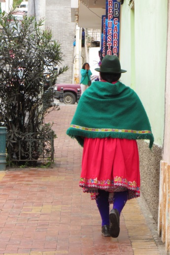Green shawl, red skirt and purple socks in Alausi