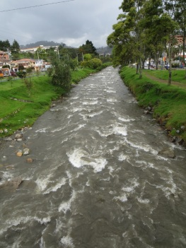 Fast flowing river through Cuenca