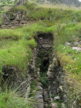 Part of the overgrown drainage system at Chavin