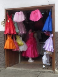 One of the many small dress shops selling very brightly coloured clothes