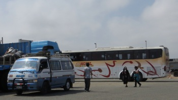 Lunch stop - typical 'collectivo' in the front and our bus at the back