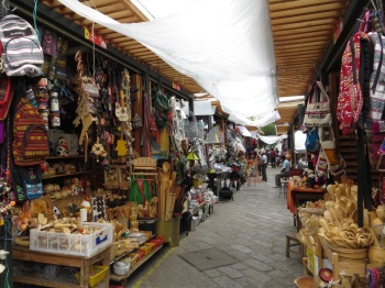 Market selling baskets and household goods