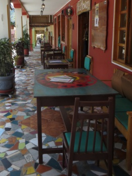 Cafe tables under the verandah in Vilcabamba