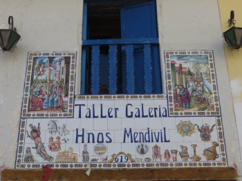 Typical decorated sign over a shop in San Blas