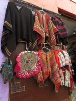 Men's ponchos for sale in a shop in Pisac