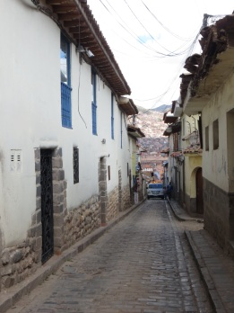 Cusco streets are very narrow (and not all one way!). Inca stones are on the bottom half of the houses.