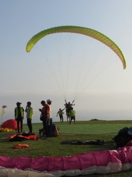 Preparing to paraglide off the cliffs at Miraflores