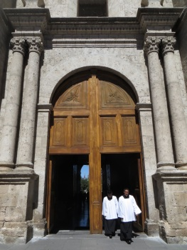 Priests coming out of the 'back' entrance of the Cathedral