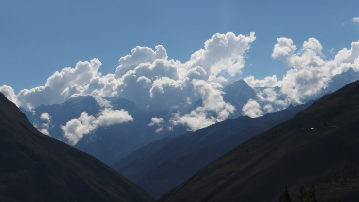 Clouds hanging over the snowy mountain tops