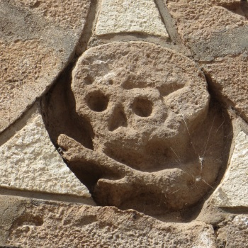 A cheery little carving at the entrance to the cemetery