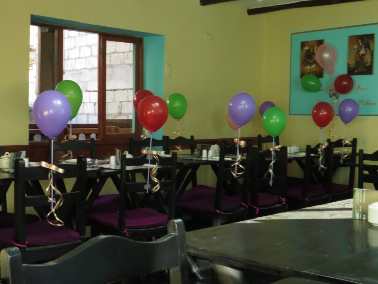 Table set up for a birthday party in the Sacred Heart cafe