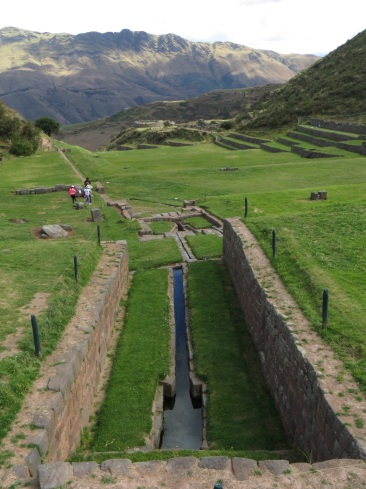 Water canal goes right through the terraces at Tipon