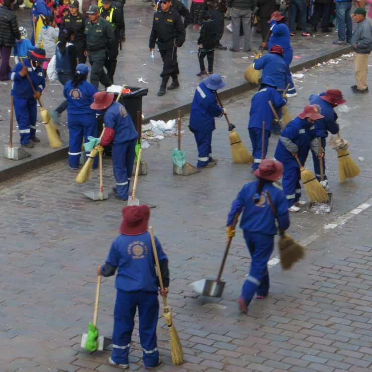 Street cleaners at work in the Plaza