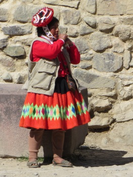 Local lady resting her load in Ollantaytambo