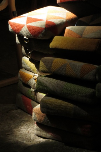 Sunlight on a pile of hassocks in the Cathedral