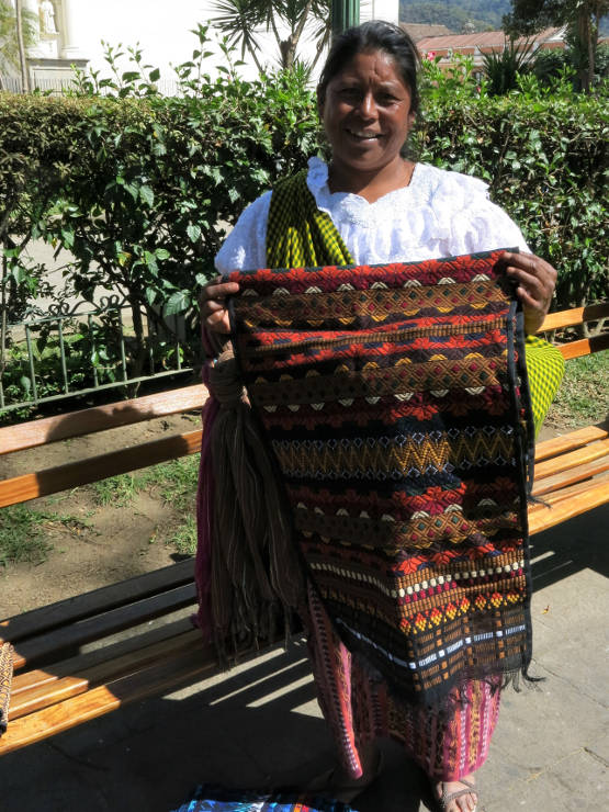 Cloth seller at a park bench in Antigua, Guatemala