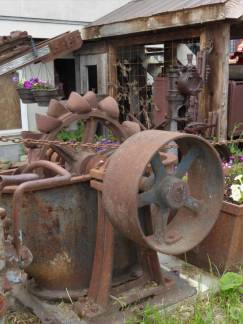 Assortment of old machinery in garden in Kaslo