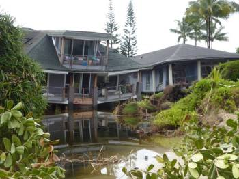 Collapsed houses on Hanalei Beach