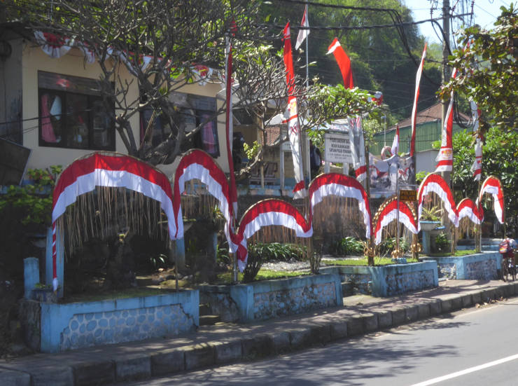 Independence Day flags outside police station