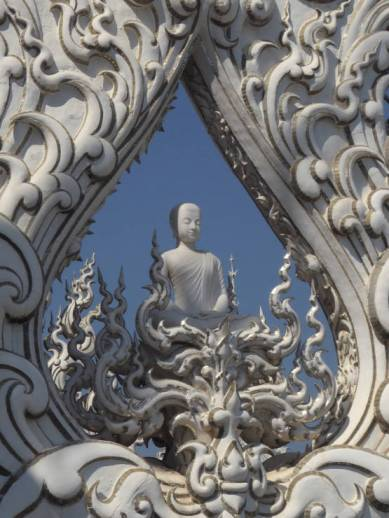 Buddha on roofline of White Temple