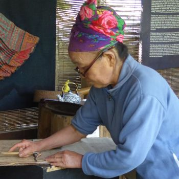 Hmong lady demonstrating batik