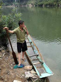 Our boatman with his leaky boat