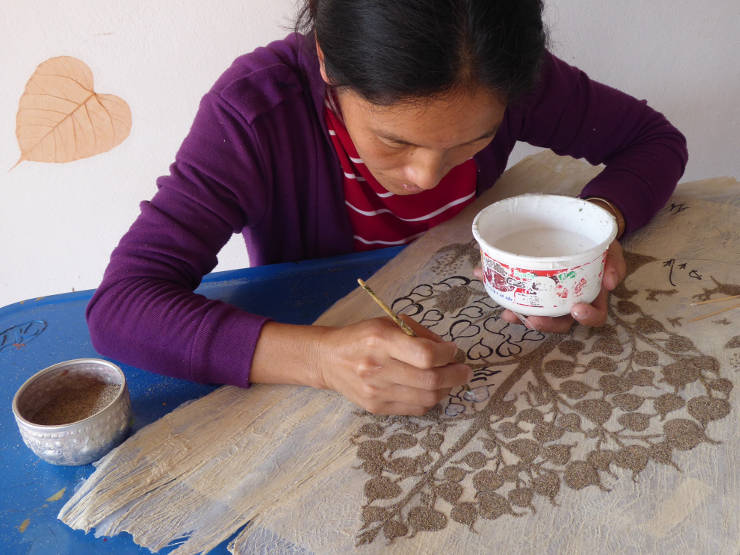 Painting a sand Tree of Life on hand made paper