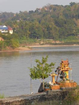 Shrine overlooking the Mekong