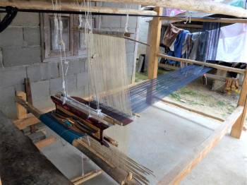Weaving loom outside a house